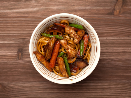 chinese food: Chinese Noodles for Wok on wooden background Stock Photo