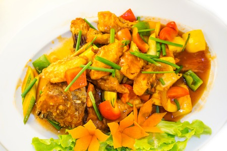 close up food: Fried fish with vegetables on the plate served with vegetables