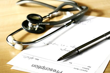 doctors medical perscription and stethoscope photo