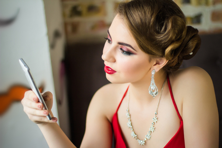 Retro image. Girl with beautiful eye make-up and red lips closeup Stock Photo