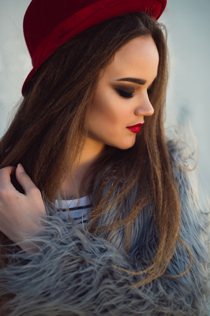 Portrait of a girl with long hair, red lips and a hat close up Banque d'images - 100371149