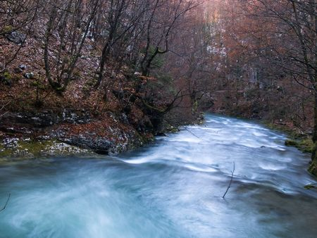 late fall: River flowing through small canyon in late fall