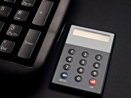 Security net banking token next to keyboard. Stock Photo - 3179172