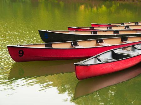 canoes: Boats on a lake Stock Photo
