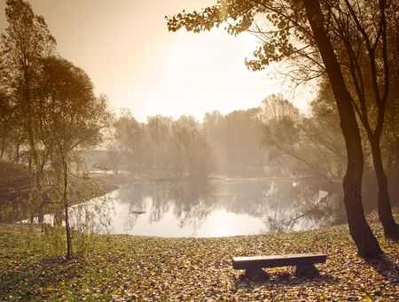 Early morning over small lake with sepia toned sky. Stock Photo - 6786243
