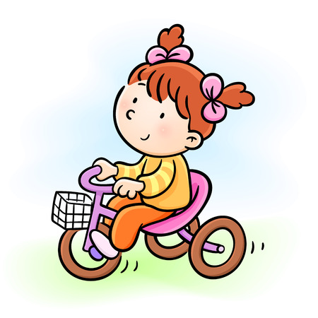 baby girl riding a tricycle