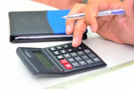 offiice: Calculator and hand