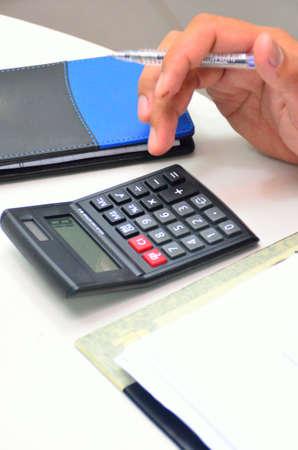 offiice: Calculator at work