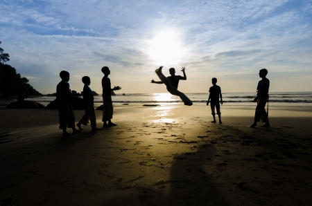 Showcase a martial arts at the beach photo