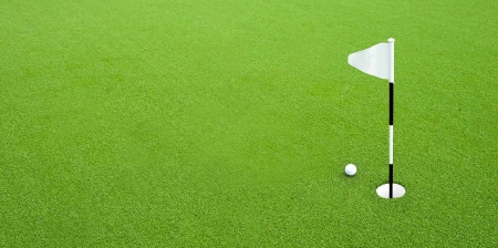 Golf ball on green grass next hole photo