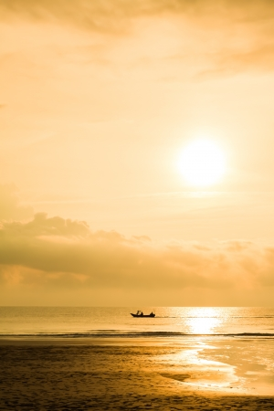Fishing boat when sun rising photo