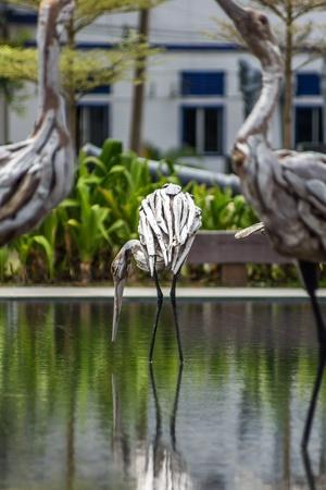 wood carvings: Wood carvings of birds in the water