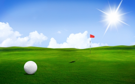 Golf ball in a course with striking colours and Sun Light photo