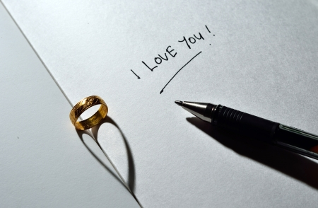 Ring with heart shadow and I love you text with pen photo
