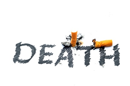 Cigarette butt with DEATH text isolated on white photo