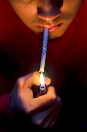 Man lighting up cigarette photo