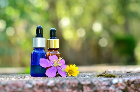 Essence oil with flower Stock Photo - 20152523