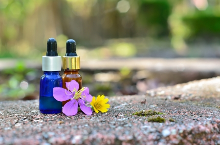 Essence oil with flower photo