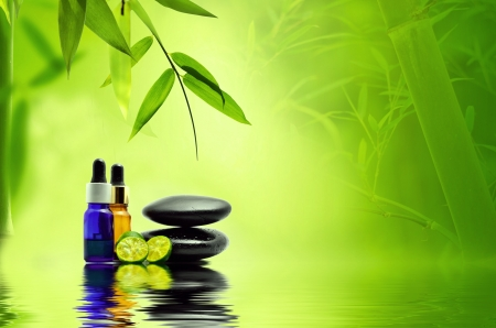 Essence oil, zen stone and calamansi in spa concept photo