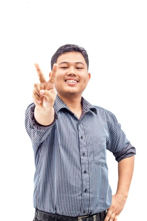 two persons only: Happy smiling young business man showing two fingers or victory gesture, isolated over white background