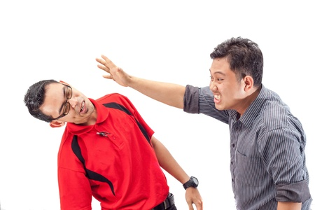 slap: angry businessman is slapping across the businessmans face