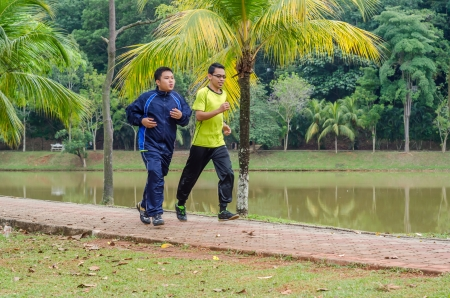 Two Young man jogging in park photo