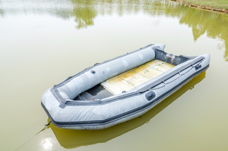 Blue inflatable boat on the water photo