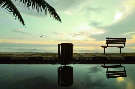 Bench near the beach waiting for sun rising up photo
