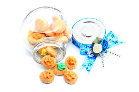 dole: Meringue Button Cookies in the bottle with blue ribbon for gift Stock Photo