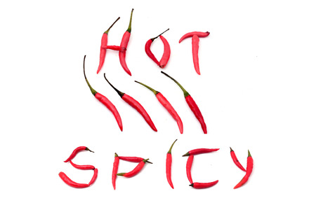 Red hot and spicy chili peppers alphabet on white photo