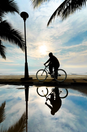 Silhoutte of man on the bicycle photo