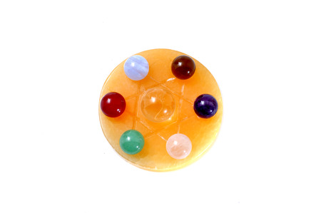 Group of natural colorful gemstones on star of david isolated on the white background. photo
