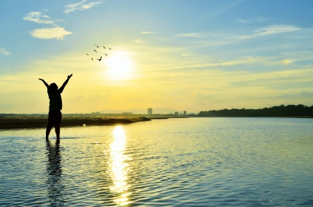 arm of a man: Silhouette of Man Raising His Hands or Open arms when sunset