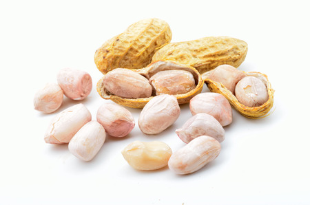 pygmy nuts: fresh ground nuts isolated on a white