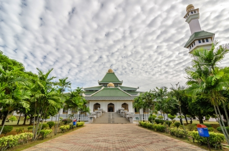 Al Azim mosque with stunning blue sky and cloud photo