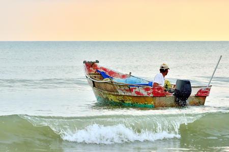Fishermen ready to go to the sea at the morning  photo