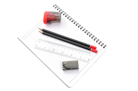 Blank page with pencils, eraser, ruler and sharpener isolated on white background photo