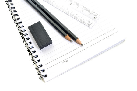 Blank page with pencils, eraserand ruler isolated on white background photo