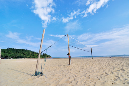 A beach volleyball net on a sunny day photo