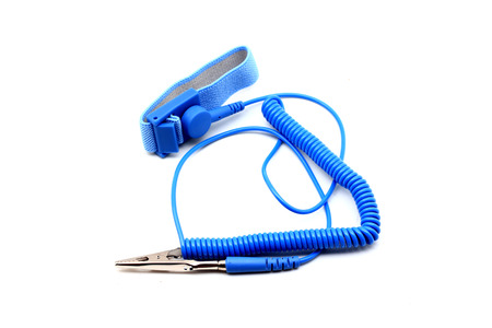 safely: Antistatic wrist strap, ESD wrist strap, or ground bracelet is an antistatic device used to safely ground a person working on very sensitive electronic equipment. Isolated on white background.