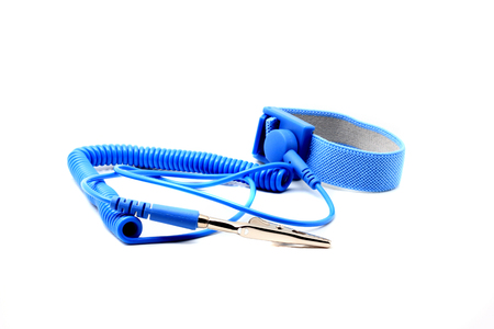 Antistatic wrist strap, ESD wrist strap, or ground bracelet is an antistatic device used to safely ground a person working on very sensitive electronic equipment. Isolated on white background.