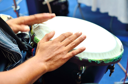 Playing the drum. Focus on the hand and other hand in motion photo