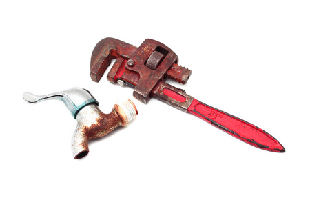 Dirty and rusty pipe wrench with taps Stock Photo - 27639954