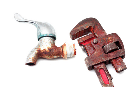 Dirty and rusty pipe wrench with taps Stock Photo - 27639955