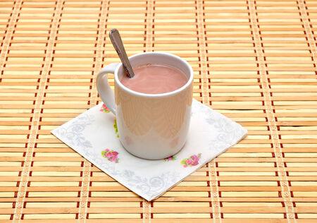 White Glass of hot chocolate on bamboo mat photo