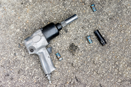 Impact air wrench and bolts. photo