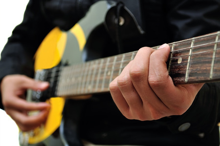 guitar pick: Playing the Guitar Stock Photo
