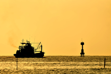 Boat on the sea at sunset photo