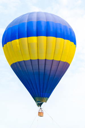 Colorful Hot Air Balloons in Flight over blue sky photo