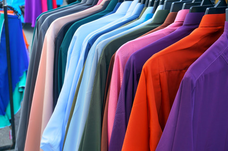 row of colorful row shirts hanging on photo